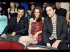 Kristen Stewart is sandwiched by her 'The Twilight Saga: Eclipse' co-stars Taylor Lautner and Robert Pattinson at the 2011 MTV Movie Awards.