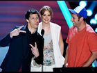 Andy Samberg, Leighton Meester and Adam Sandler photographed on stage while presenting the Best Kiss award at the 2012 MTV Movie Awards in Los Angeles.