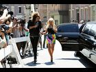 Russell Brand is hypnotized by Christina Aguilera's multi-colored skirt as they walk hand-in-hand to the 2008 MTV Video Music Awards press conference