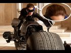 "Unlike the comics, however, the Catwoman of ""Dark Knight Rises"" is sporting Hathaway's long brown hair, not the short black hair that we see most often."