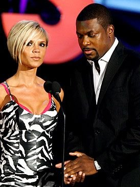 Busted! <i>Rush Hour 3</i> star Chris Tucker gets an eyeful of co-presenter, Victoria 'Posh Spice' Beckham.